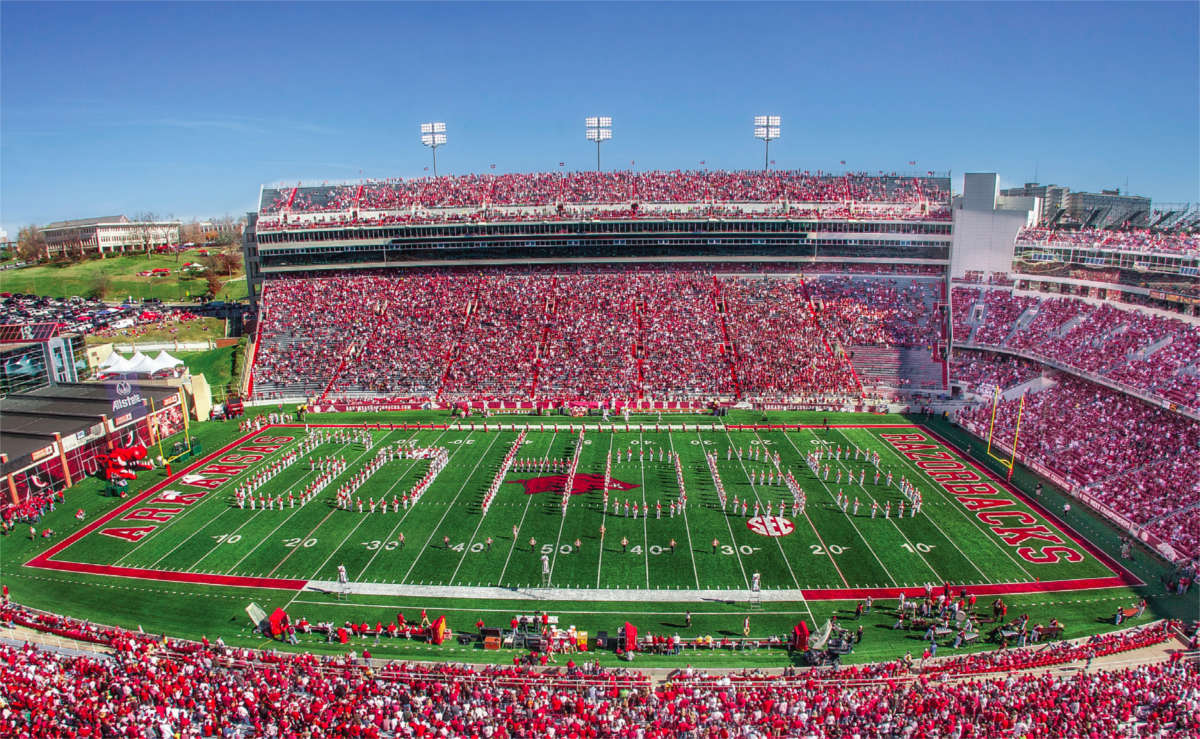University of Arkansas marching band spelling out Go Hogs on the football field.